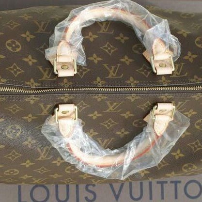 Photo taken at Louis Vuitton by kaew n. on 11/30/2011