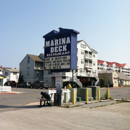 Photo taken at Marina Deck Resturant by Roy C. on 7/20/2011