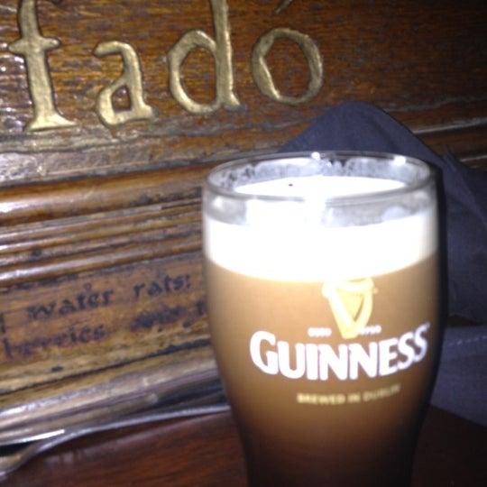Photo taken at Fadó Irish Pub & Restaurant by Sarah P. on 3/13/2012