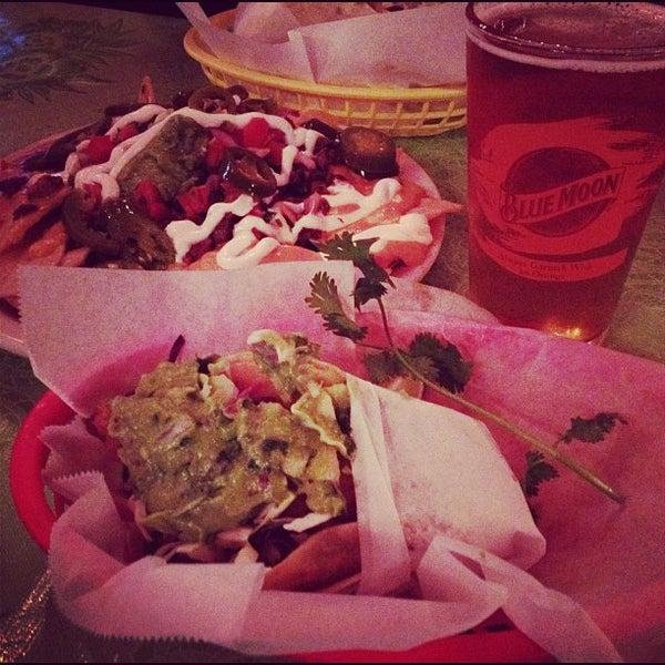 Photo taken at Nick's Crispy Tacos by Jenn N. on 6/1/2012