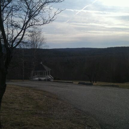 Photo taken at The Lucerne Inn by Cait D. on 3/24/2012
