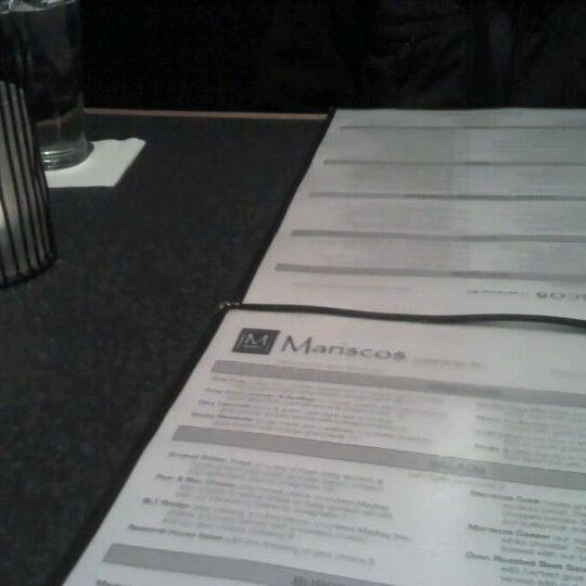 Photo taken at Mariscos Restaurant by Erica W. on 1/14/2012