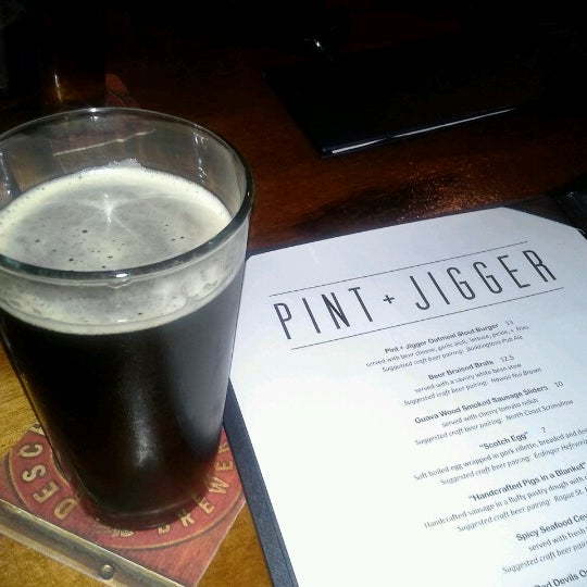Photo taken at Pint + Jigger by crystal n. on 6/28/2012