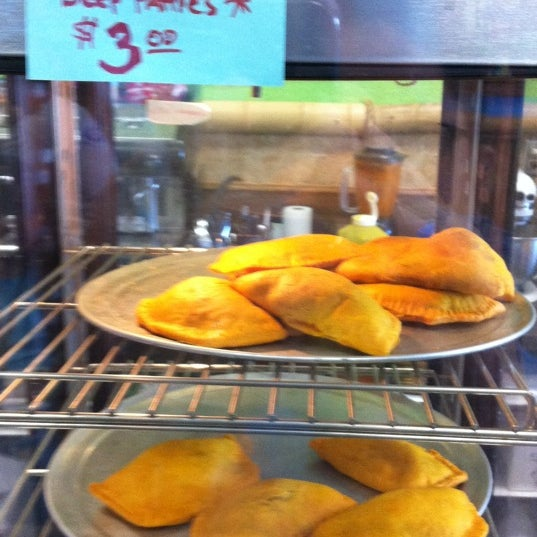 Photo taken at Mama Jamaica's Kitchen by Conrad & Jenn R. on 2/17/2012