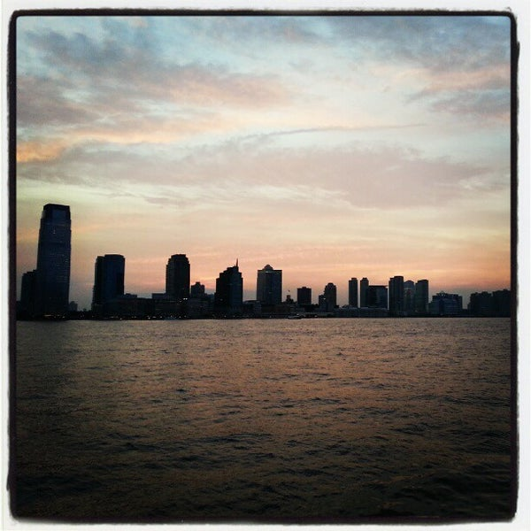 Photo taken at Battery Park City Esplanade by Brian K. on 7/7/2012