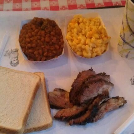 Photo taken at John Brown Smokehouse by Elizabeth C. on 8/29/2011