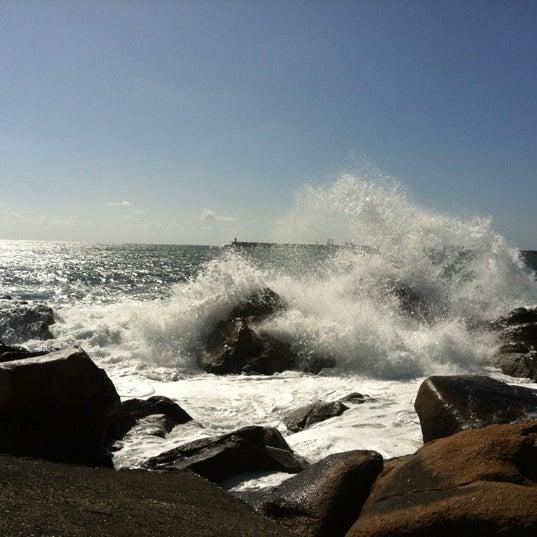 Photo taken at Praia do Titan by Lenyсуа T. on 6/8/2012