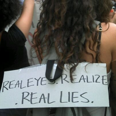 Photo taken at #OccupyMiami by Ledvi B. on 10/15/2011
