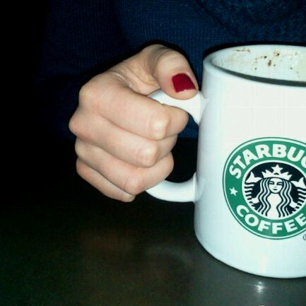 Photo taken at Starbucks by Cezary Z. on 12/11/2011