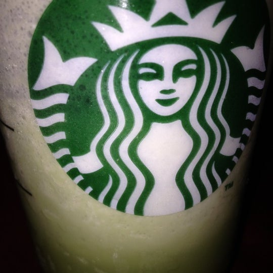 Photo taken at Starbucks by jo ann q. on 7/11/2012