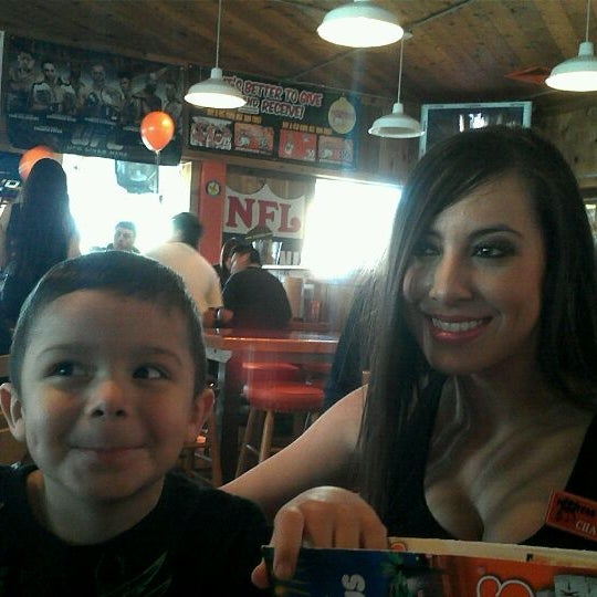 Photo taken at Hooters of Ontario by Elizabeth D. on 12/23/2011