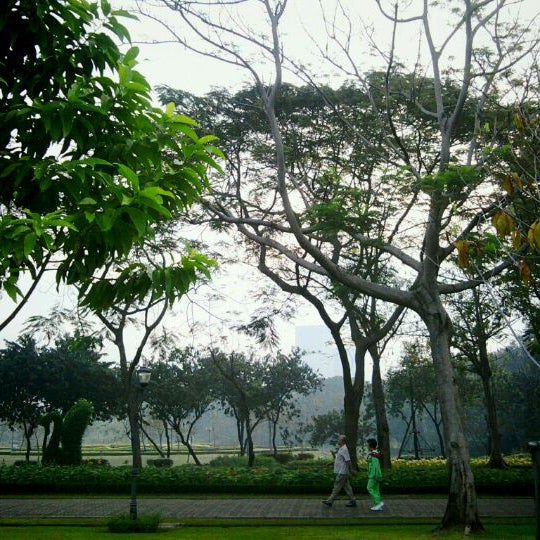 Photo taken at Queen Sirikit Park by Oil K. on 1/31/2011