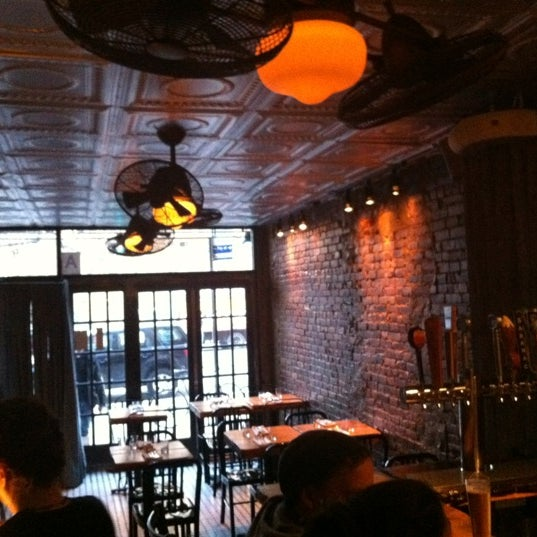 Photo taken at Upstate Craft Beer and Oyster Bar by Kevin M. on 2/19/2012