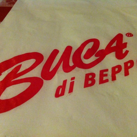 Photo taken at Buca di Beppo by Alfonso C. on 6/4/2012
