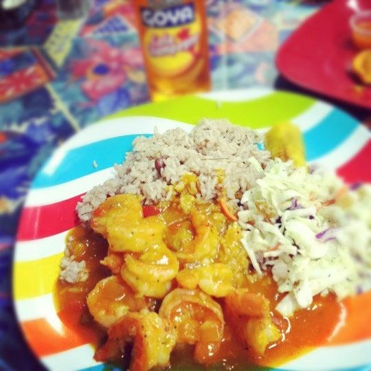 Photo taken at Mama Jamaica's Kitchen by Stephanie R. on 5/10/2012