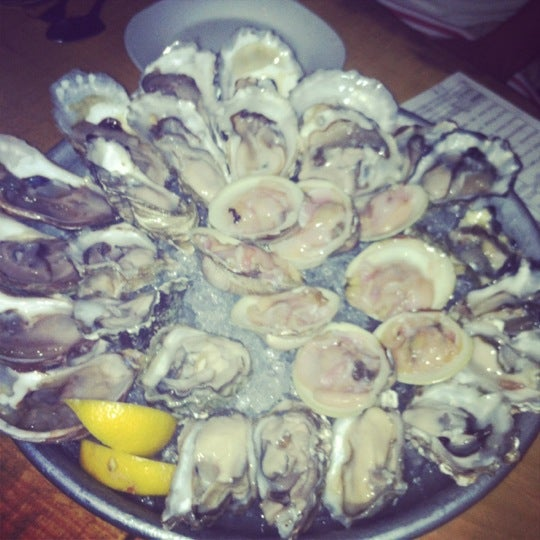 Photo taken at Upstate Craft Beer and Oyster Bar by Mariel M. on 6/30/2012