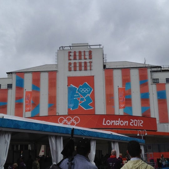 Photo taken at Earls Court Exhibition Centre by Lorenza M. on 7/31/2012