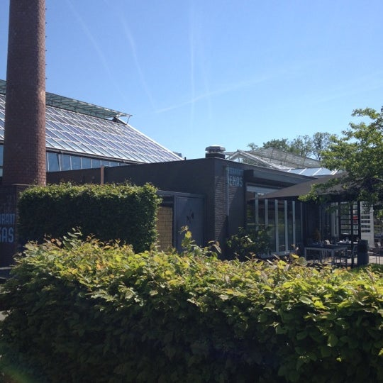 Photo taken at De Kas by Sandra S. on 5/25/2012