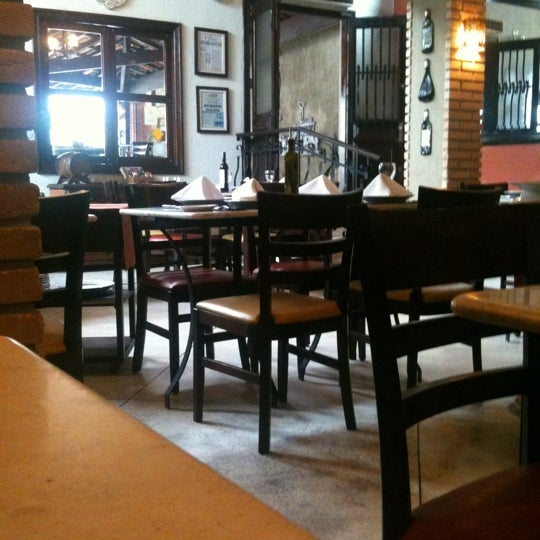 Photo taken at Canal 4 Restaurante e Pizzaria by Ana Cristina S. on 9/9/2012
