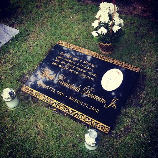 Photo taken at Manila Memorial Park by Pia P. on 8/23/2012