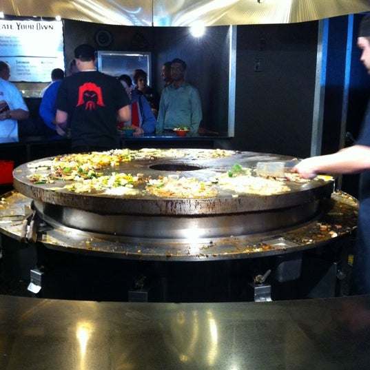Photo taken at HuHot Mongolian Grill by LC o. on 1/4/2011