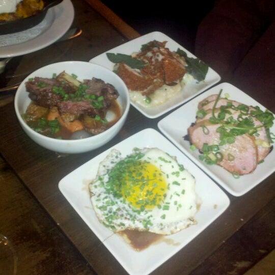 Photo taken at The Tavern Kitchen & Bar by Megan M. on 1/4/2012