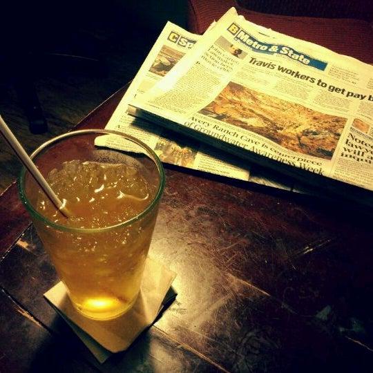 Photo taken at Bennu Coffee by Jin C. on 3/14/2012
