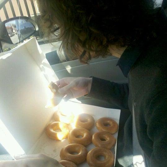 Photo taken at Krispy Kreme Doughnuts by Jarel K. on 11/17/2011