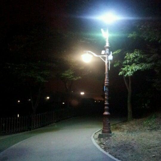 Photo taken at Yuldong Park by Yoo H. on 8/28/2011