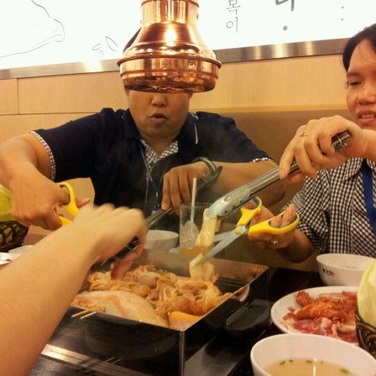 Photo taken at Kimju by Noppharat T. on 12/29/2011