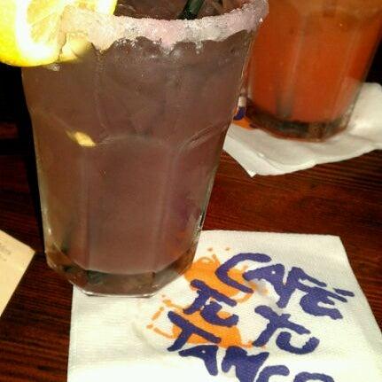Photo taken at Café Tu Tu Tango by April N. on 12/15/2011