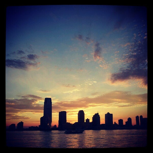 Photo taken at Battery Park City Esplanade by Koen B. on 6/10/2012