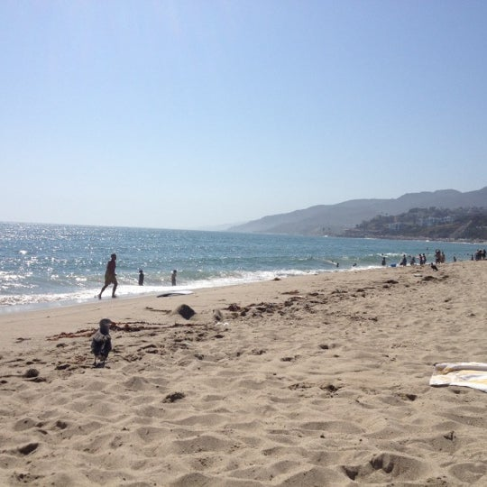 Photo taken at Pacific Palisades Beach by Matt W. on 9/2/2012