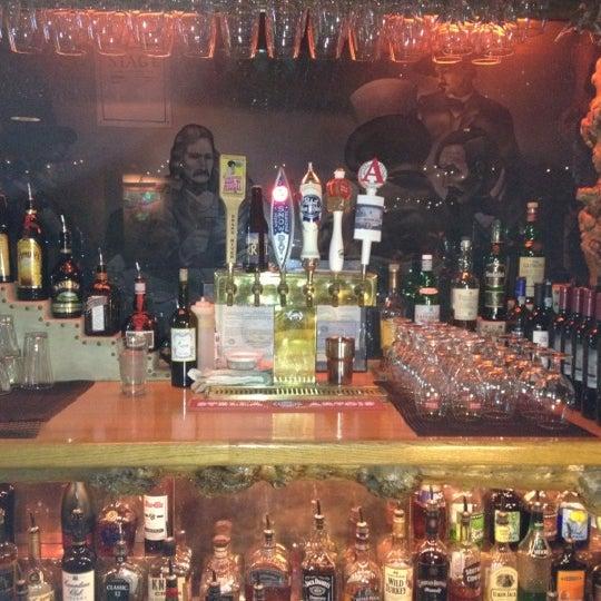 Photo taken at Million Dollar Cowboy Bar by Tom F. on 12/19/2011
