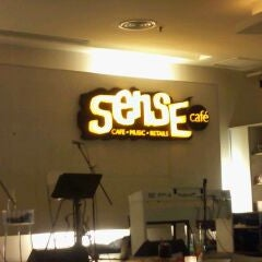 Photo taken at Sense Cafe by Lily on 10/27/2011