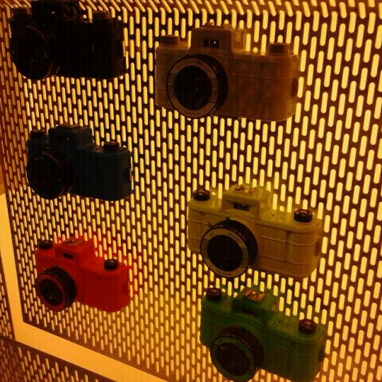 Photo taken at Lomography Gallery Store by Marcela C. on 12/10/2011