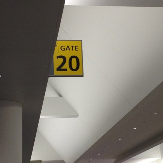 Photo taken at Gate 20 by Ilana F. on 3/3/2012