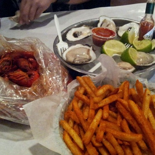 Photo taken at The Boiling Crab by Jennifer on 2/1/2012