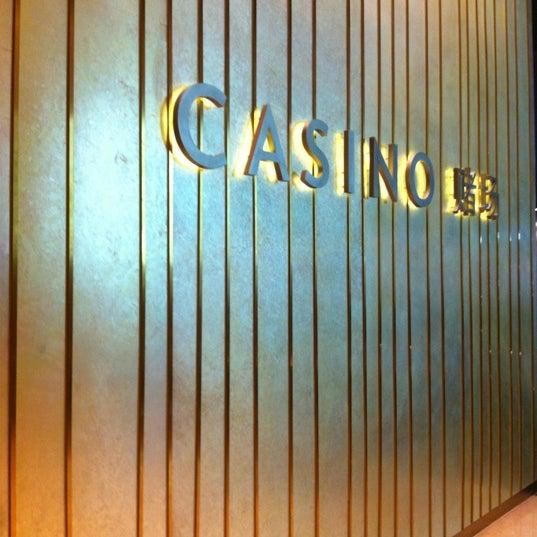 Photo taken at Marina Bay Sands Casino by Poonyapat P. on 4/13/2012