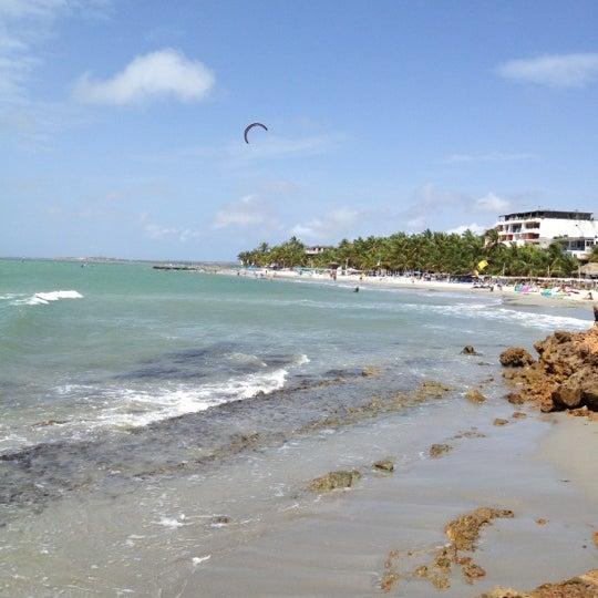 Photo taken at Playa El Yaque by Carinadb on 3/2/2012