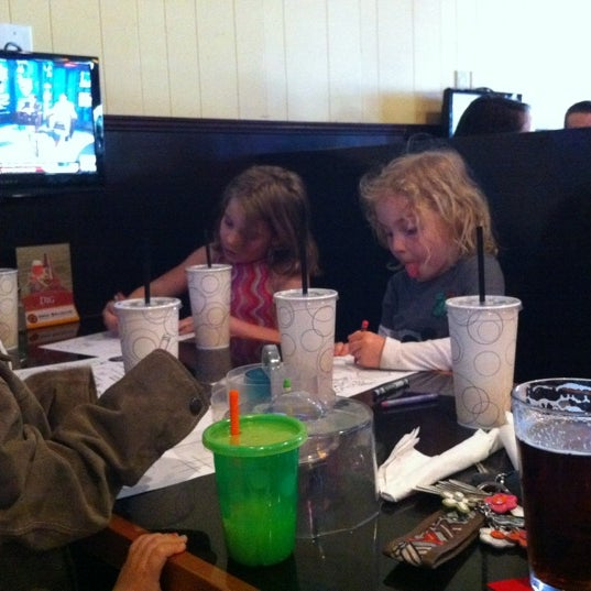 Photo taken at Gus' Bar & Grill by Kate S. on 4/17/2012