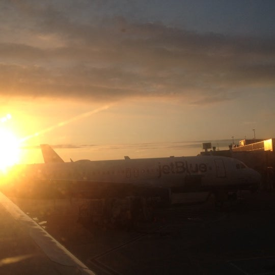 Photo taken at Gate 20 by Guillermo R. on 7/30/2012