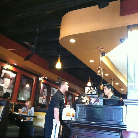 Photo taken at Alondra Hot Wings by Louis C. on 6/17/2012