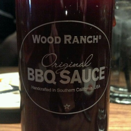 Photo taken at Wood Ranch BBQ & Grill by Eric S. on 2/1/2012