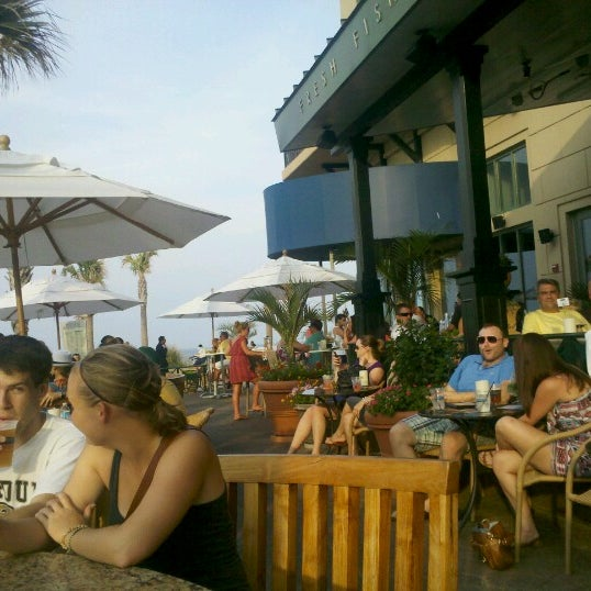 Photo taken at Catch 31 Fish House and Bar by Kim F. on 7/7/2012
