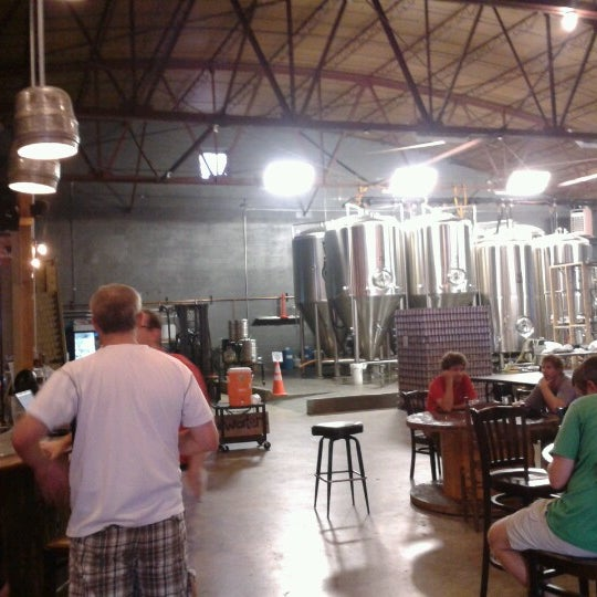 Photo taken at Good People Brewing Company by Manny H. on 8/2/2012