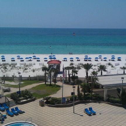 Photo taken at Hilton Pensacola Beach by Tina K. on 5/8/2012