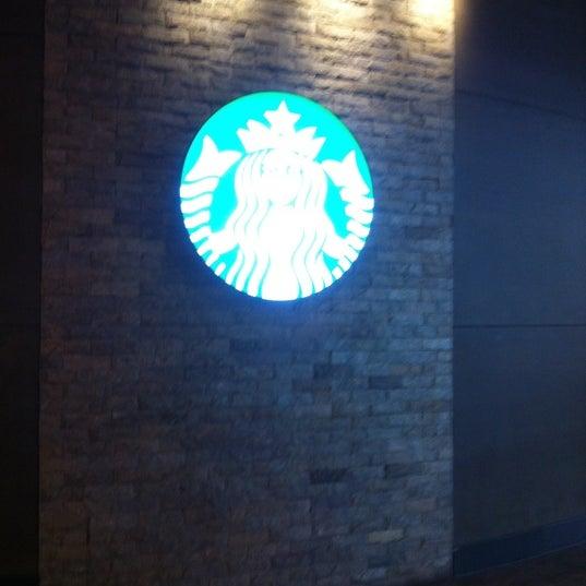 Photo taken at Starbucks by Kwanchanok S. on 4/14/2012