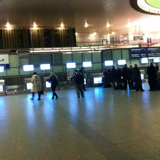 Photo taken at Check-in desk by Kseniya K. on 2/21/2012