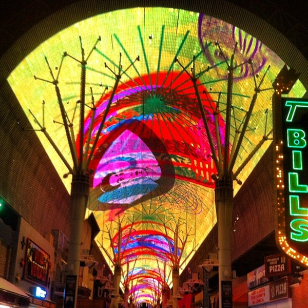 Photo taken at Fremont Street Experience by Michael B. on 8/18/2012
